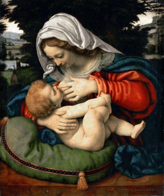 Madonna dando leche al niño